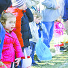 Lyla Susong, 2, waits the start of Saturday's Easter egg hunt at Lebanon Memorial Park.