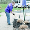 Lori Montag, an associate with Kohl's, spreads mulch Thursday morning, April 11, at the Boys and Girls Club of Zionsville East location. Montag was one of nearly 20 volunteers at the location doing grounds work for the club as part of the Kohl's National Go Green event in celebration of National Volunteer Week and Earth Day. In addition to spending several hours at the club mulching, removing weeds and other yardwork, Kohl's will donate nearly $7,000 in grants to the club.