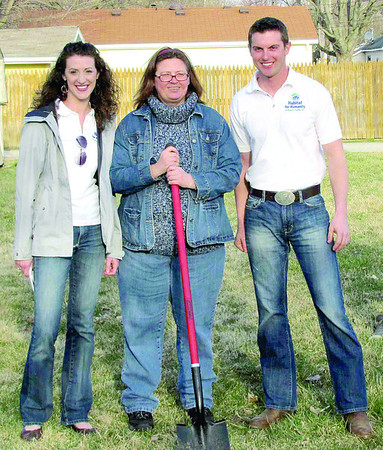 Anita Kolp poses during a groundbreaking ceremony with Natalee and Dustin Baker, Habitat for Humanity of Boone County board of directors members. The groundbreaking was the first ceremony this year. Kolp's future home site is at 1411 S. Meridian St., Lebanon.