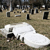 Reporter photo by Rod Rose<br /> A tombstone so weathered its inscription is indecipherable lies cracked in half at the Old Cemetery in Thorntown, one of dozens of grave markers damaged by two children.