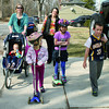 The Price and Finnell families took advantage of the pleasant spring weather by hiking home from Eagle Elementary after a basketball clinic Friday, March 21. Kate, 5, and Bridget, 7, Finnell stayed ahead of the pack, though, on their scooters, while 19-month-old Elinor Finnell rolled along in a stroller pushed by her mom. Maria Finnell. Twins Mitchell and Thomas (not pictured) Price, 10, were hoofing it along with their mom, Beth Price.