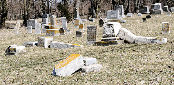Reporter photo by Rod Rose<br /> About 100 tombstones at the Old Cemetery in Thorntown, including the five shown, were damaged by two children last week.