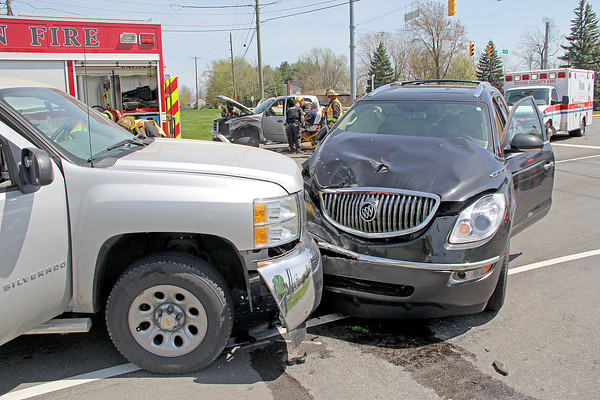 Rod Rose The Lebanon Reporter<br /> MULTIPLE INJURIES: Firefighters place Rodney L. Gilreath, 63, Lebanon, onto a gurney at a three-vehicle crash that closed state Route 39 at Anderson Lane for about 30 minutes Monday afternoon. Lebanon police said Derrick Smith, 31, Frankfort, driver of the black Buick Enclave in foreground, drove through a red light northbound, striking Gilreath's GMC pickup in the right side. The impact forced the Buick into the path of a Chevrolet Silverado, left foreground, southbound on SR 39 driven by Ross L. Dukes, 60, Lebanon. The three drivers and a passenger in Dukes' truck were taken to Witham Memorial Hospital with non-life-treatening injuries, police said.
