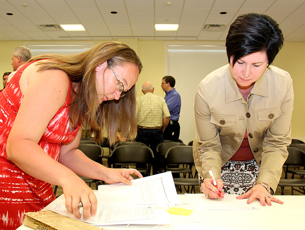 Rod Rose The Lebanon Reporter<br /> INCOMING AUDITOR: Carla Newcomer (right) signs paperwork provided by County Clerk Jessica Fouts (left) after Newcomer was chosen by a GOP caucus to succeed Deanna Willhoite as Boone County Auditor.