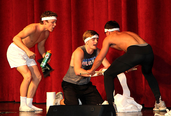 TOTALLY COMMITTED: Lebanon High School junior Clayton Barber unrolled eight rolls of toilet paper in under 2:30 for talent portion of the Mr. LHS contest Saturday night at the high school. Five juniors and five seniors competed for the title of the first Mr. LHS, sponsored by DECA.