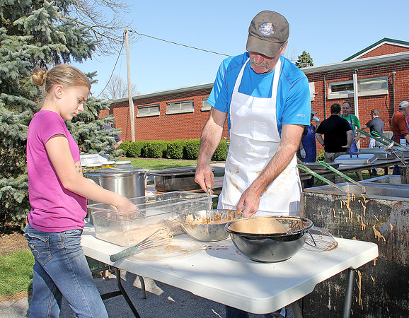 Rod Rose The Lebanon Reporter<br /> BATTERING UP: Joe Leising, with help from daughter Sydney, 13, preps fish for the fryer at Friday's St. Joseph Knights of Columbus fish fry during the Boone County Home and Garden Show at the 4-H Farigrounds in Lebanon.