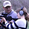 "HANDS ON: Lebanon Police Department Captain Chad Morgan, the department's lead firearms instructor, works with The Lebanon Reporter's Elizabeth Pearl on firing an AR-15 in an exercise similiar to the training officers must go through. LPD Chief Tyson Warmoth said close to 12 of LPD's officers have passed the requirements to carry AR-15s in their patrol cars. He hopes the remainder of the force will soon follow suit. ""They have to know the nomenclature, maintenance, cleaning, disassembly, reassembly, and then go to the range and learn proper handling and marksmanship and then shoot a qualifying score for this weapon to be issued to them,"" Warmoth said."