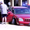"FORTUNATE OUTCOME: Judith Mullen, 76, of Darlington, is loaded onto a stretcher after her 1995 Cadillac DTS caromed down N. Lebanon Street before coming to a stop in front of Goody's. The vehicle mounted the sidewalk before striking the curb. Lebanon Police officer T.J. Nelson said the passenger, Donald Mullen, turned the ignition key off headinng south on SR 39 after he saw a ""blank look"" come across Judith's face. Donald then grabbed the wheel from th epassenger seat and steered the car down N. Lebanon St. before crashing into the curb and snapping the drive shaft of the right front wheel. Nelson said the incident could've been much worse had one of the pedestrians on the sidewalk been struck."