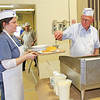 Rod Rose The Lebanon Reporter<br /> SERVING UP SECONDS: Lebanon Kiwanis member Dr. Paul Nordman piles a resupply of pancakes on plates for Lynette Clark, who was providing seconds for patrons at the 62nd annual Kiwanis pancake supper, Thursday at the Boone County 4-H Fairgrounds in Lebanon.