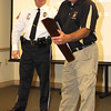 "EARNED RESPECT: Former Lebanon Police Department Chief Sam Myers (right) receives the flag flown during his watch over the department from current LPD Chief Tyson Warmoth at a retirement and promotion ceremony Friday night. It's police tradition to retire the officers' firearm and give them a retied badge with their number, and Myers received both. Warmoth said Myers, a 27-year LPD veteran, had accepted a new position with the Boone County Prosecutors office, and may become a reserve detective with LPD. ""I've had the honor of working under Sam on the shifts and we share a few war stories we cannot unfortunatley share,"" said Warmoth with a laugh. ""I hope Sam will acept the position with us and continue to serve the City of Lebanon."""