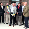 CABLE CUTTING: Lebanon Utilities General Manager Mike Whitman cuts a cable in lieu of ribbon at the dedication ceremony of the utilities' new Electric Operations Facility Building.