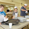 Rod Rose The Lebanon Reporter<br /> TRAY TURNAROUND TIME: William Autrey, 10, Maddy Autrey, 12, and Mark Baer scrub trays at the 62nd annual Lebanon Kiwanis pancake supper Thursday at the Boone County 4-H Fairgrounds. They are members of the Aktion Club, and were among more than 40 volunteers helping the Kiwanis Club at the event.