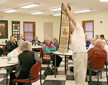 A BANNER DAY: Allen Andrews shows the 1932 banner to the audience at Boone County Senior Services Inc.