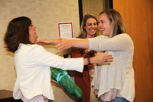 Rod Rose The Lebanon Reporter<br /> DREAM REALIZED: Alexis Klink (right) rushes to hug Gabi Youran, communciations director of the COmmunity Foundation of Boone County, after Klink was surprised with the news Wednesday that she has received a Lilly Endowment scholarship. In background is Western Boone Jr.Sr. High School counselor Jamie Klinge.