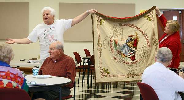 A BANNER DAY: Allen Andrews and Boone County Senior Services Inc. Director of Volunteers Judy Brower display a 1932 German flag.