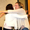 Rod Rose The Lebanon Reporter<br /> DREAM REALIZED: Alexis Klink (right) hugs Gabi Youran, communciations director of the COmmunity Foundation of Boone County, after Klink was surprised with the news Wednesday that she has received a Lilly Endowment scholarship. In background is Western Boone Jr.Sr. High School counselor Jamie Klinge.