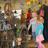 Rod Rose The Lebanon Reporter<br /> SCULPTURE GARDEN: Keelyn Douglas, 6, and Ainsley Douglas, 3, compare favorite items at the ALtra Design 2000 booth Saturday during Gardenfest 2017 in the Farm Bureau Community Building at the 4-H Fairgrounds in Lebanon. Jerry Whisenhunt, who with his wife Penny own Altra Designs, are from Huntingtom. Saturday's event was one of 60 shows they'll visit this year in Indiana, Illinois and Ohio, he said. Gardenfest is sponsored by the Boone County Master Gardeners and Purdue Extension Boone County.