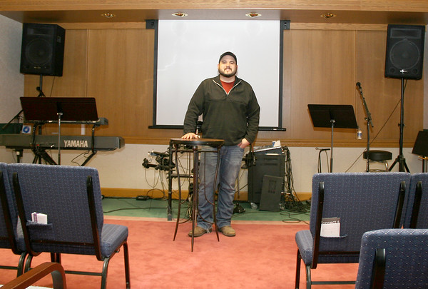 ACCESS: Lead Pastor Dusty Taylor in Access Church's temporary sanctuary. The congregation has been meeting there since November, but will soon move to the permanent sanctuary when construction is complete.