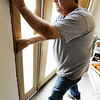 Globe/T. Rob Brown<br /> Samaritan's Purse volunteer Jim Hover installs new door trim Thursday afternoon, April 5, 2012, at the Joplin home of Megan Snider.