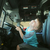 Globe/Roger Nomer<br /> Lannum Litherland, 5, Seneca, takes in the new digs of Fire Station #6 from inside the cab of a fire truck on Saturday morning.
