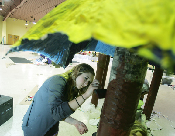 Globe/Roger Nomer<br /> Erin Lawellin, Joplin High junior, paints a mushroom in preparation for Saturday's prom.