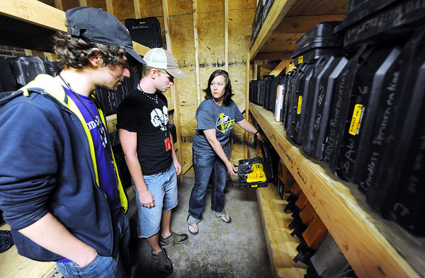 Globe/T. Rob Brown<br /> Amy Ipsen, Transform Joplin volunteer and co-owner of the warehouse with her husband, shows construction gear to volunteers Logan Schultz, left, and John McElroy, both Cornell College students from Mt. Vernon, Iowa, as they prepare to go out for tornado recovery efforts Monday morning, April 2, 2012. The group of about 17 students were here as part of their college's Alternative Spring Break project.