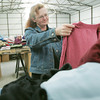 Globe/Roger Nomer<br /> Michele Rodrigue, Joplin, looks a shirt while browsing at the clothing give away on Thursday.