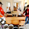 Globe/T. Rob Brown<br /> Samaritan's Purse volunteers Lowell Fish, left, of Delta, and Natalie Ebenhoch, of Mukwonago, Wis., move a vanity cabinet to the bathroom Thursday afternoon, April 5, 2012, at the Joplin home of Megan Snider.