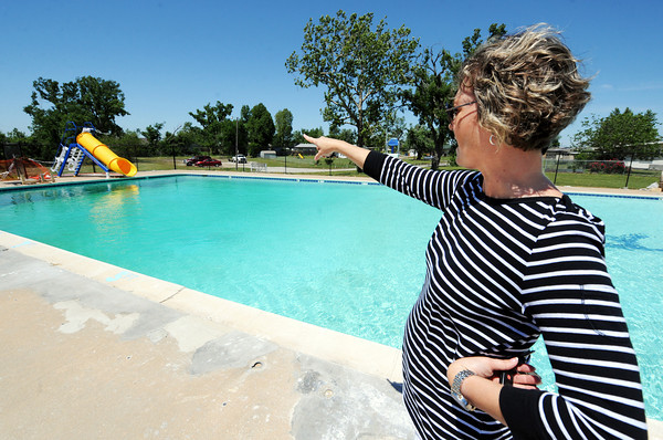 Globe/T. Rob Brown<br /> Kelli Owen, of Joplin, treasurer of the Rosedale Private Swimming Pool board, points to the pool's newest addition while talking about tornado repairs and improvements Tuesday afternoon, April 24, 2012.
