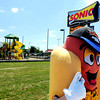 "Globe/T. Rob Brown<br /> Charlie the Chili Cheese Coney, portrayed by crew leader Emily Yarbrough, waves outside the new Range Line Road Sonic location Monday afternoon, April 23, 2012, to let motorists know the store has reopened for business. The previous location near 20th and Range Line Road was destroyed during the May 22, 2011, tornado. The new location is near 11th and Range Line Road, where Pizza Inn used to be. ""I'm here and I love it,"" Yarbrough said. The new location features a large playground and a sand volleyball court."