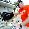 Globe/T. Rob Brown<br /> Samaritan's Purse volunteer Lowell Fish, of Delata, cuts pieces of door trim Thursday afternoon, April 5, 2012, at the Joplin home of Megan Snider.