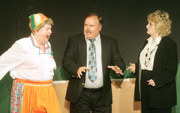 """Globe/Roger Nomer<br /> Stephen Biddle, played by Doug Dickey, tries to break up a fight between Dolly Biddle, played by Betty Bell, left, and Isobel Lomax, played by Betsy Fleischaker, in a scene from """"Kitchen Witches"""" at the Stone's Throw Theater."""