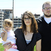 Globe/T. Rob Brown<br /> Courtney Grisham, left, of Greenfield and formerly of Joplin, holds her 2-year-old daughter, Emily, as they stand next to Matt Hutchison, of Joplin, with St. John's Regional Medical Center (now Mercy) in the background, at Cunningham Park in Joplin Tuesday afternoon, April 27, 2012.