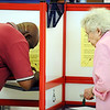 Globe/T. Rob Brown<br /> Joplin voters JD Love, left, and Dorothy Donaldson make their decision in the voting booths Tuesday afternoon, April 3, 2012, at the Donald E. Clark Public Safety & Justice Center in Joplin.