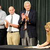 Globe/T. Rob Brown<br /> Natalie Fox, right, of Carl Junction, signs with the MSSU Honors Program Friday morning, April 27, 2012, at MSSU's Corley Auditorum in Webster Hall. MSSU officials, from left, Steve Smith, assistant Honors Program director and geography professor, Dr. Michael Howarth, Honors Program director, and Dr. A.J. Anglin, vice president for academic affairs, clap.