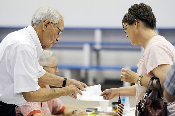 Globe/T. Rob Brown<br /> Joplin voter Rhonda McCash, right, speaks with supervisory election judge George Edwards Tuesday morning, April 3, 2012, in Precinct 26 at Fellowship Baptist Church.