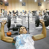 Globe/Roger Nomer<br /> Raul Canales lifts weights at the Pittsburg YMCA on Tuesday morning.  Today, the Pittsburg YMCA celebrates its 125th birthday.