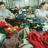 Globe/Roger Nomer<br /> Lily Cudmore, left, from Boston, and Marissa Coble, Burlington N.C., both with Americorp NCCC, fold childrens clothing at a give away on Thursday.