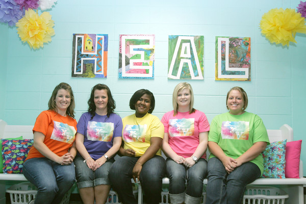 Globe/Roger Nomer<br /> (from left) Missouri Southern students Jessica Davis, sophomore, Lisa Miller, sophomore, Mercedes Childs, sophomore, Casey Van Story, junior, and Shavonne McCoy, senior, gave a makeover to the children victims waiting room at the Joplin Courthouse.