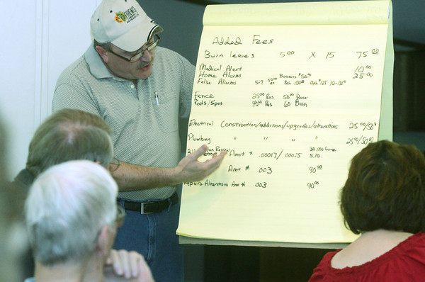 Globe/Roger Nomer<br /> Michael White, a resident of Silver Creek Village, talks about the added fees he belives residents will face if annexed into Joplin during a Board of Trustees meeting on Tuesday night.