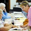 Globe/T. Rob Brown<br /> Joplin voter Karen Stewart, right, signs up for a ballot with supervisory election judge Diana Fleischaker, left, Tuesday morning, April 3, 2012, in Precinct 24 at Bethany Presbyterian Church.