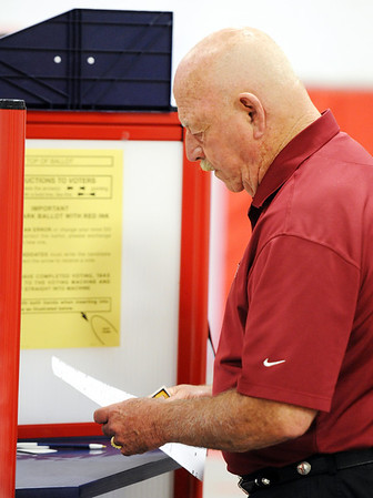 Globe/T. Rob Brown<br /> Joplin voter Ken Lovett looks at his options Tuesday morning, April 3, 2012, in Precinct 26 at Fellowship Baptist Church.