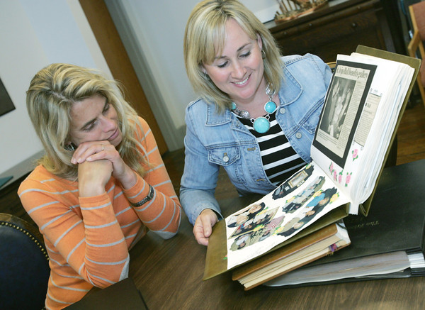 Globe/Roger Nomer<br /> Current St. Avips co-chairs Shannon Satterlee, left and Louise Secker look through a scrapbook of past St. Avips fundraisers.