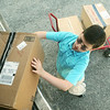 Globe/Roger Nomer<br /> On Monday afternoon, Nico Bowman helps load boxes for his upcoming rummage sale at the Joplin Museum Complex.