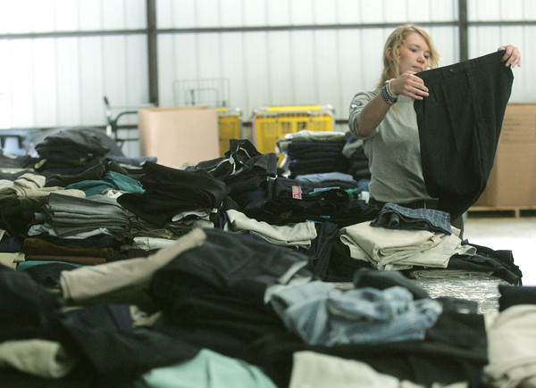 Globe/Roger Nomer<br /> Dallas Willis, from Bompass, Virginia, with Americorps NCCC, folds mens pants on Thursday.
