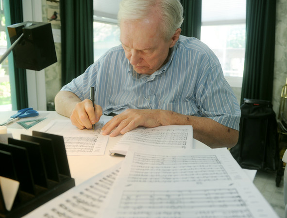 "Globe/Roger Nomer<br /> Hubert Bird works on composing the score to ""The Other Side of Storm"" at his Baxter Springs home on Thursday."
