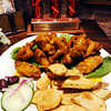 Globe/T. Rob Brown<br /> Mango wings at Caldone's, 218 S. Main St., Joplin, in front of the 2011 Emancipation Commitee King of Wings Cook-Off Champion trophy.