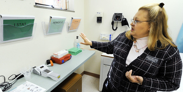 Globe/T. Rob Brown<br /> Community Clinic Executive Director Barbara Bilton, R.N., talks about the clinic's new laboratory Monday morning, April 23, 2012.