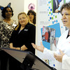 Globe/T. Rob Brown<br /> Carla Orner, right, laboratory specialist with Heart to Heart International, speaks during the ribbon-cutting ceremony for the new laboratory at the Community Clinic Tuesday morning, April 24, 2012, as a group, including Executive Director Barbara Bilton, center, look on.