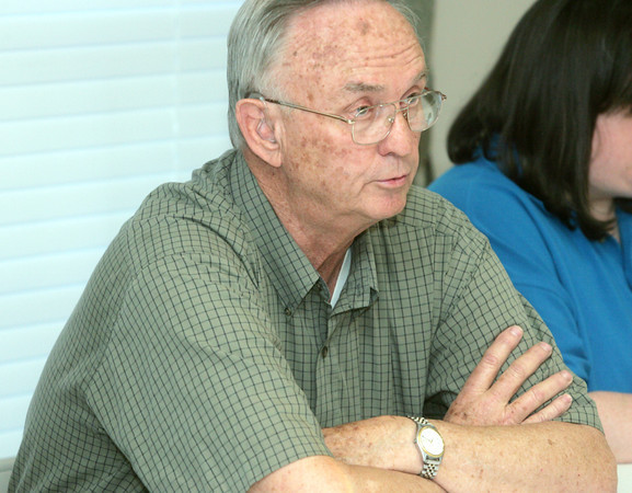 Globe/Roger Nomer<br />  Pat Worley, chairman of the Silver Creek Board of Trustees, talks with residents during a meeting on Tuesday night.